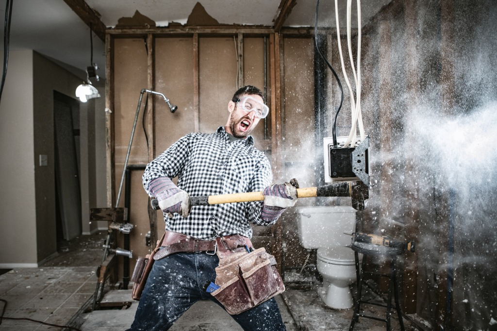 contractor-man-doing-home-improvement-and-demolition-picture-id1089045626